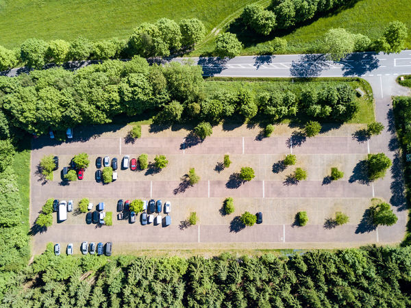 parking spce - drone photography - high angle view Agriculture Beauty In Nature Day Field Green Color Growth High Angle View Land Land Vehicle Landscape Mode Of Transportation Nature No People Outdoors Plant Rural Scene Scenics - Nature Sunlight Tranquility Transportation Tree