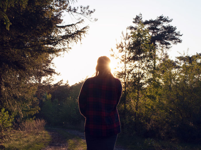 Back Lit Beauty In Nature Casual Clothing Day Grass Growth Idyllic Landscape Leisure Activity Lens Flare Lifestyles Nature Non-urban Scene Outdoors Scenics Sky Standing Sun Sunbeam Sunlight Sunset Tranquil Scene Tranquility Tree Unrecognizable Person