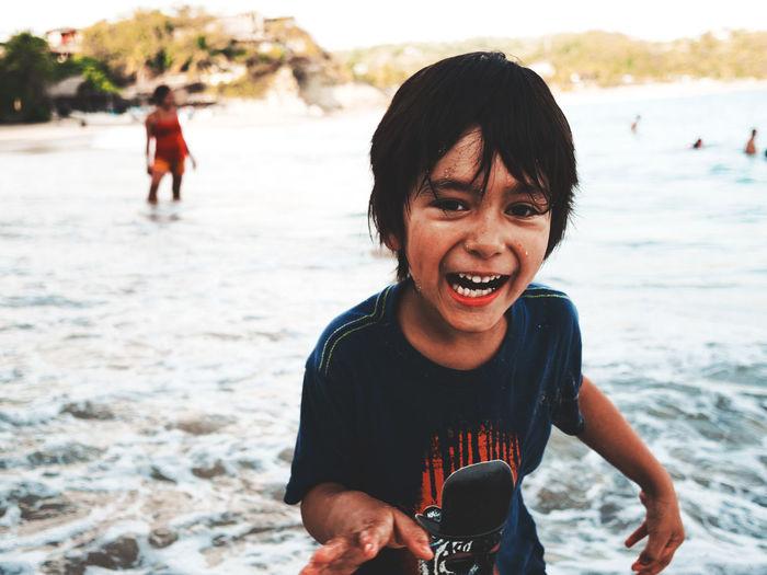 Portrait of happy boy at beach