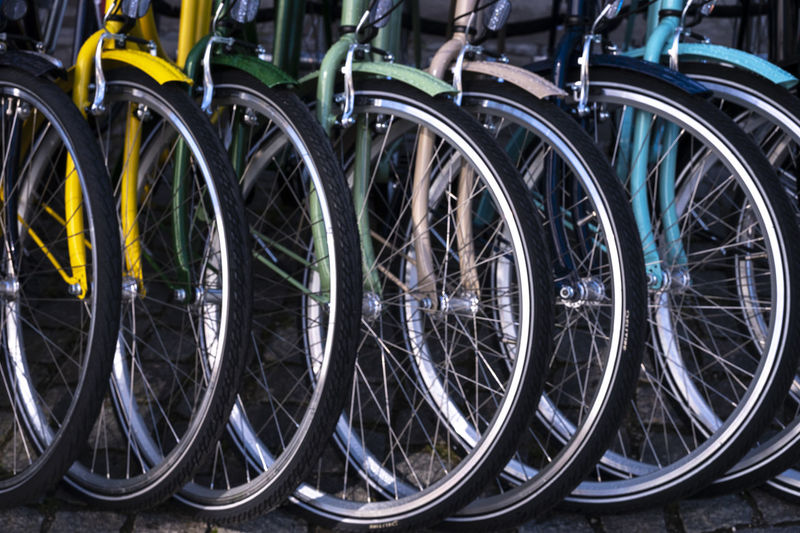 Close-up of bicycle wheel in row