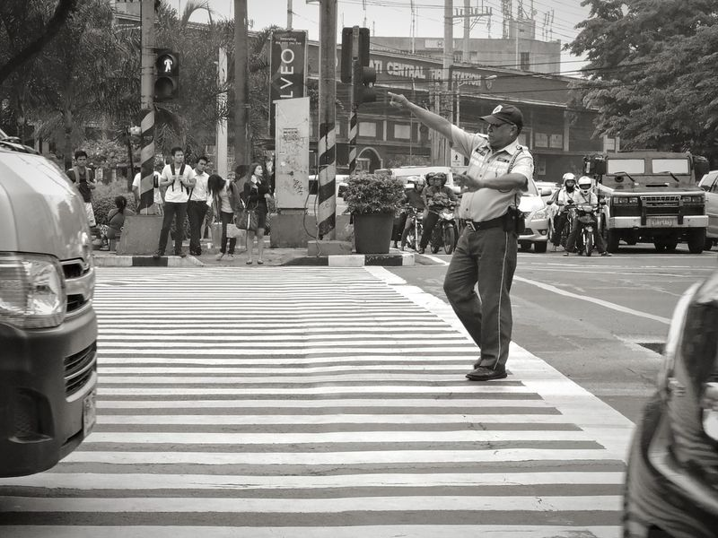Face of the Street 2 : Stop - Go Red Light Green Light Stop Go Traffic Enforcer Body Movement Pedestrians Street Life Everyday Life Ayala Eyeem Philippines Street Photography Black And White Photography