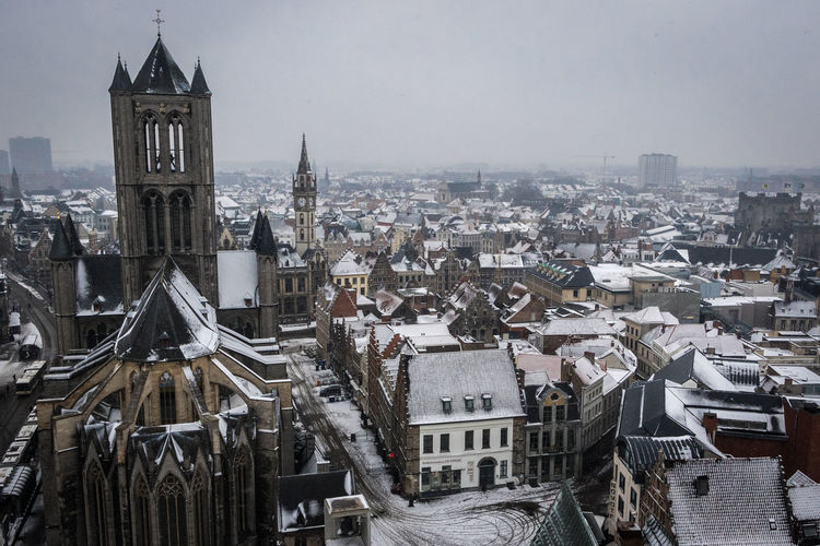 Ghent with snow Gent Ghent Belgium Belgique Belgium. Belgique. Belgie. Belgien. Etc. Snow Architecture Building Exterior Built Structure City Sky Day Outdoors Building Cityscape Tower Residential District High Angle View Roof Travel Destinations Place Of Worship Church
