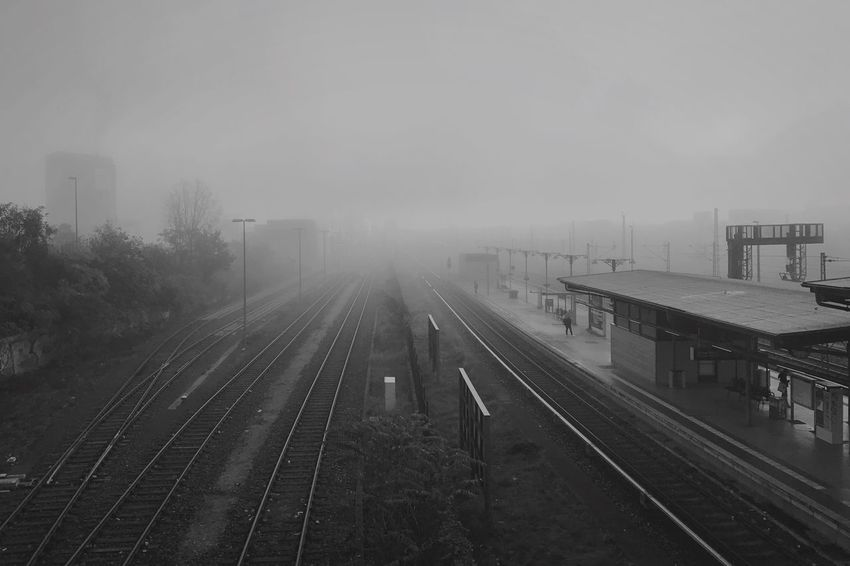Railroad Track Transportation Rail Transportation Public Transportation Fog Eye4photography  Shootermag Melancholic Landscapes Bonjour Tristesse Railway Track High Angle View Weather Mode Of Transport Cold Temperature Train - Vehicle Track Outdoors Day Railroad Station Platform No People Sky Architecture Nature