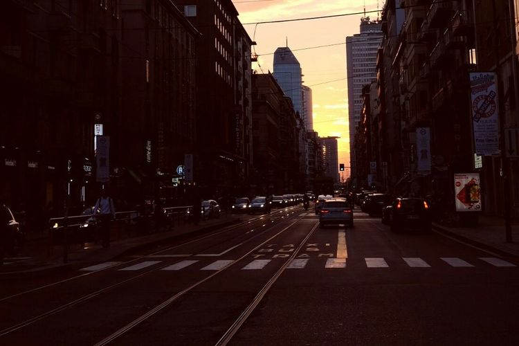 View of city street at dusk