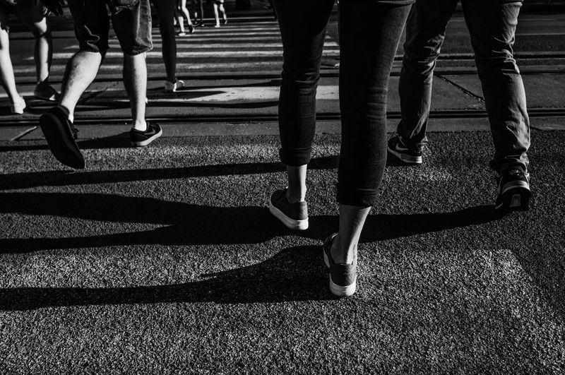 Body Part City Day Group Of People Human Body Part Human Foot Human Leg Human Limb Lifestyles Low Section Marathon Men Motion Nature Outdoors People Real People Shadow Shoe Street Sunlight Transportation Walking Women