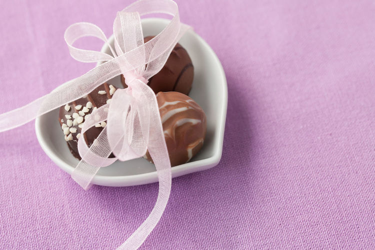 High Angle View Of Chocolates In Bowl On Table