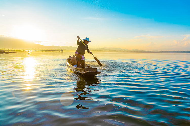 Sunlight Nature Leisure Activity Adventure Horizon Transportation Nautical Vessel One Person Sunset Adult Beauty In Nature Sky Horizon Over Water Outdoors Sun Sea Oar Men Reflection Water Lens Flare Lifestyles