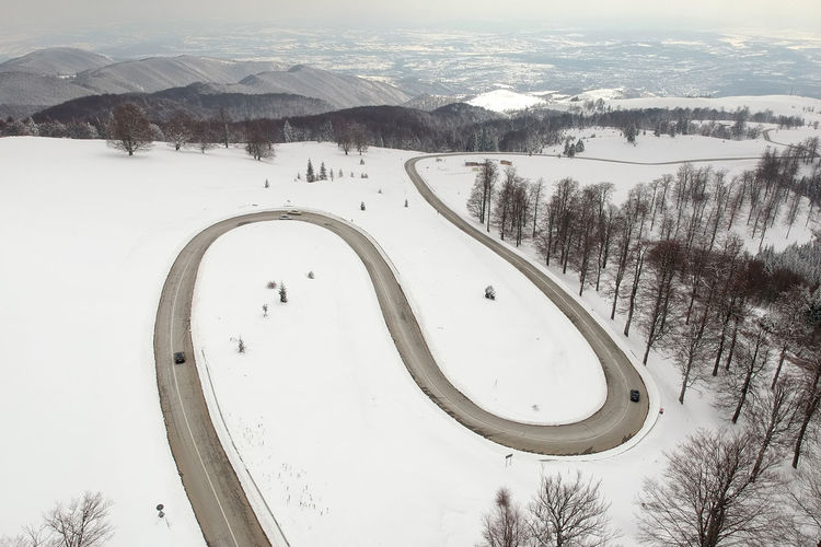 Winter aerial view above the mountain road Drone  Road Romania Transfagaraşan Travel Winter Aerial Mountain Mountain Road Nature Scenics Transalpina Transportation White