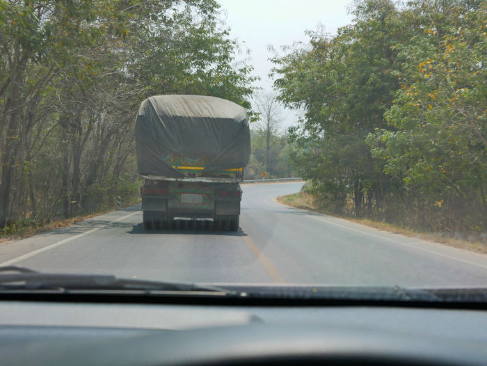 Driving behind big truck in Thailand - driver's point of view / perspective Transportation Tree Land Vehicle Road Travel Day Nature Driver's Driving Inside In A Car View Point Of View Perspective Drove BIG Truck Carry Transport Street Road Asphalt Highway Thai Thailand Following Behind After