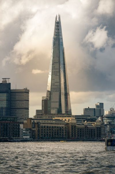 The Shard also known as the Shard of Glass formerly known as London Bridge Tower as seen from The Thames London Londonbridge Shardofglass Shardofglasslondon Thames Theshard Theshardatsunset Theshardlondon