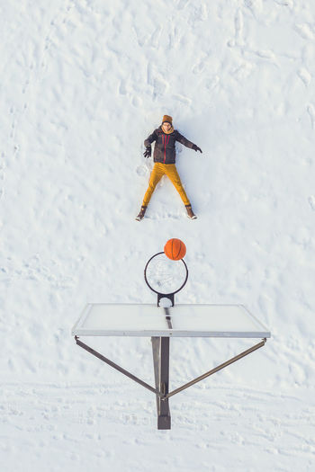 Winter basketball Drone  Aerial View Aerial Mavic 2 Mavic 2 Pro Drone Photography DJI X Eyeem Dji Lithuania Lietuva Europe Winter Wintertime Winter Wonderland Winter Basketball Basketball Sport Active Lifestyle  Man Young Adult Fun Snow Cold Temperature Field White Color High Angle View Nature Day Covering Winter Sport Land Full Length Mountain One Person Human Representation Leisure Activity Frozen Warm Clothing Snowing