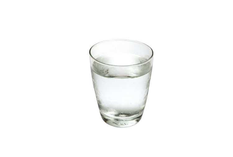 Close-up of glass of water against white background
