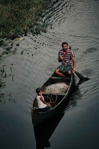 High angle portrait of man in boat on lake