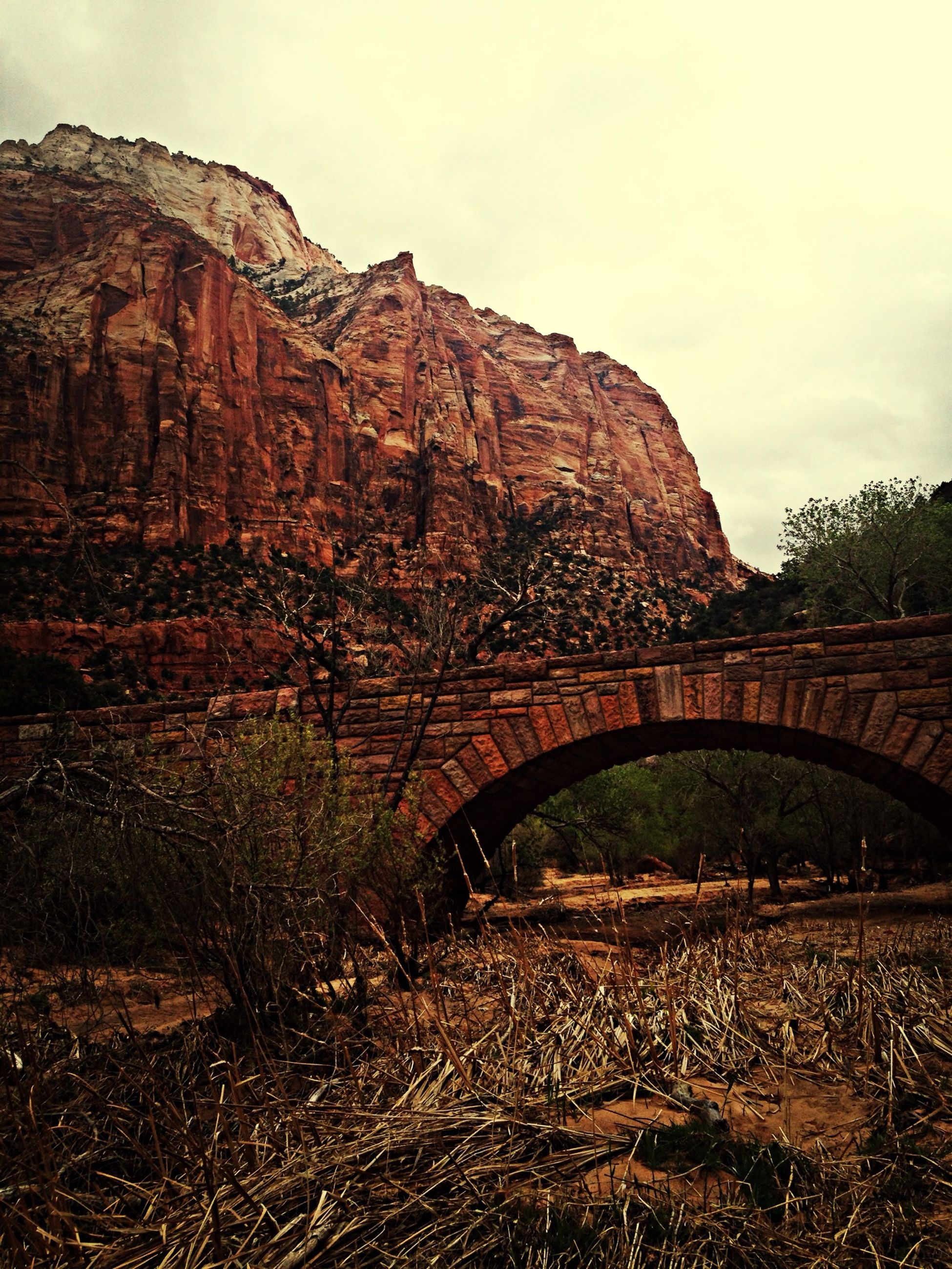 arch, connection, built structure, bridge - man made structure, architecture, sky, transportation, arch bridge, tunnel, day, tranquility, bridge, outdoors, landscape, no people, nature, tree, mountain, tranquil scene, the way forward
