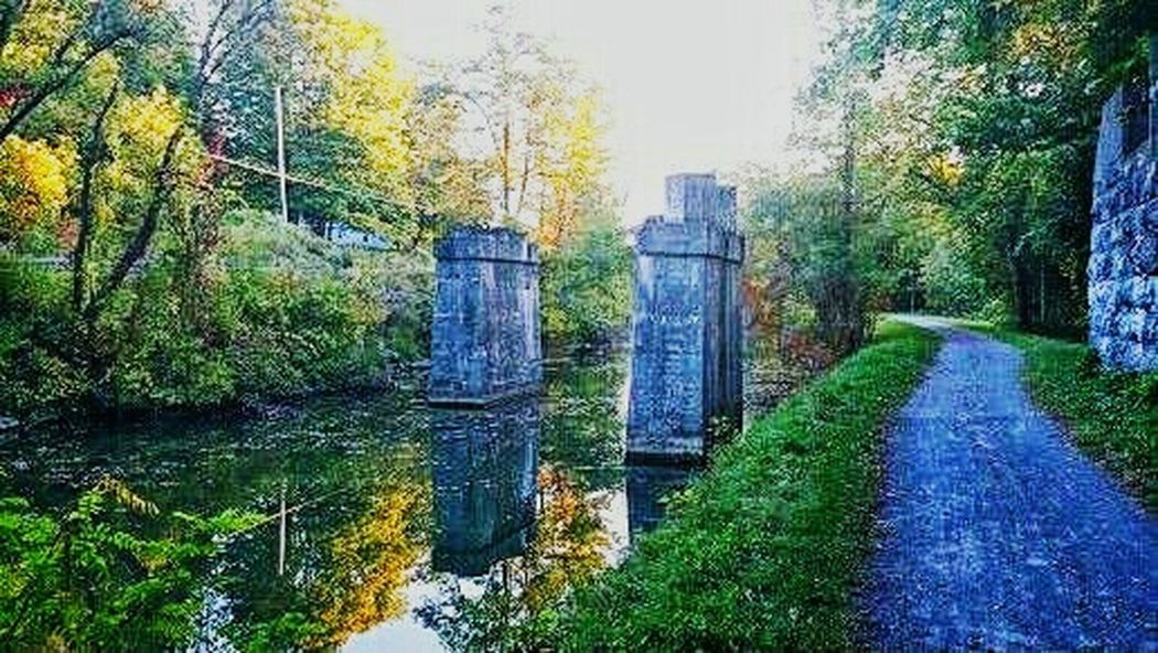 The Erie Canal Old Bridge Towpath Water Reflections Fall Foliage EyeEm Nature Lover EyeEm Best Shots This is part of the original Erie Canal in NY State. The path on the right was for horses. They towed the barges to town to deliver goods. Hence, 'Towpath.' Untold Stories