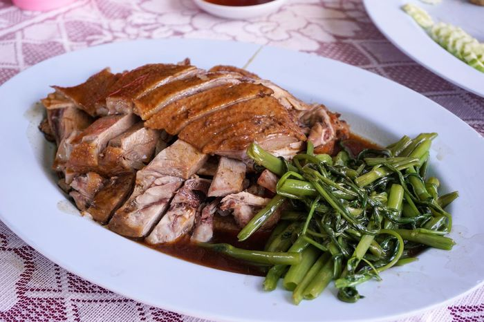 Cuisine Braised Close-up Day Delicious Duck Food Food And Drink Freshness Healthy Eating High Angle View Indoors  Meat No People Plate Ready-to-eat Restaurant Roast Swamp Morning Glory Table Tablecloth Tasty Vegetable Water Convolvulus