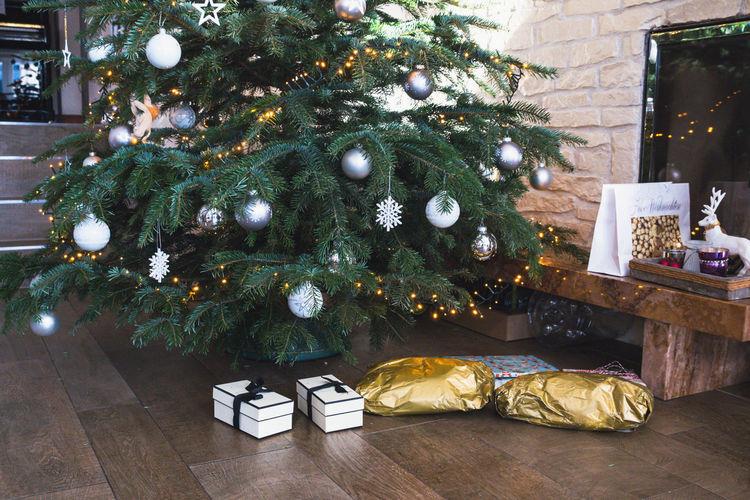 Illuminated christmas tree on floor