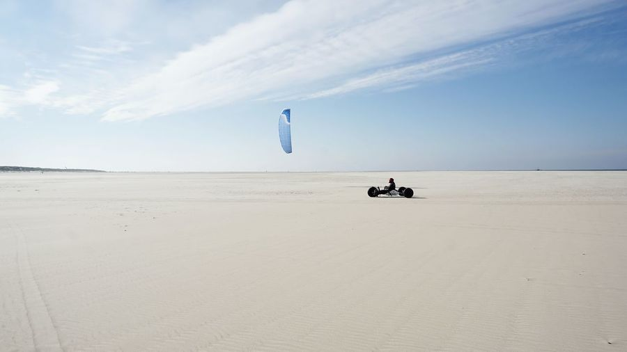 Man Kite Buggy At Beach Against Sky