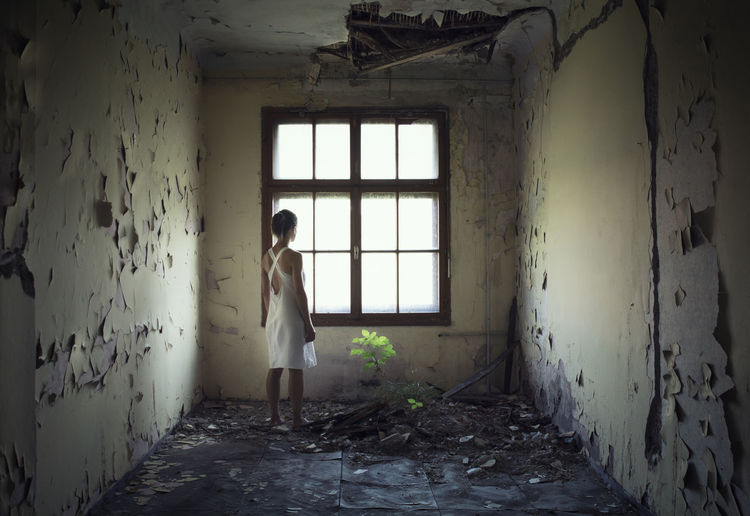 Woman Standing In Abandoned Home