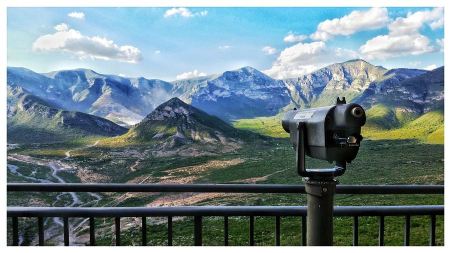 Scenic view of mountains from lookout point with a binocular