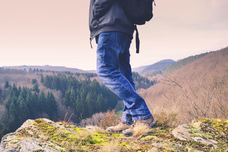 taking a hike Leisure Activity Spring To Summer Almost Summer Outdoors Copy Space Active Lifestyle  Low Section Mountain Standing Human Leg Jeans Sunlight Hiking Walking Sunset Hiker Pine Woodland Pinaceae Pine Wood Summer Exploratorium The Traveler - 2018 EyeEm Awards