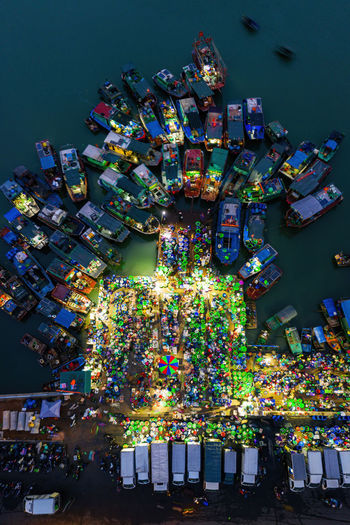 Aerial view of illuminated harbor at night
