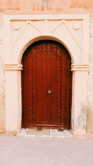 An old real moroccan door Door Arch Architecture Outdoors Building Exterior History City Street Beautiful Morocco Closed Entrance Façade No People Built Structure Day