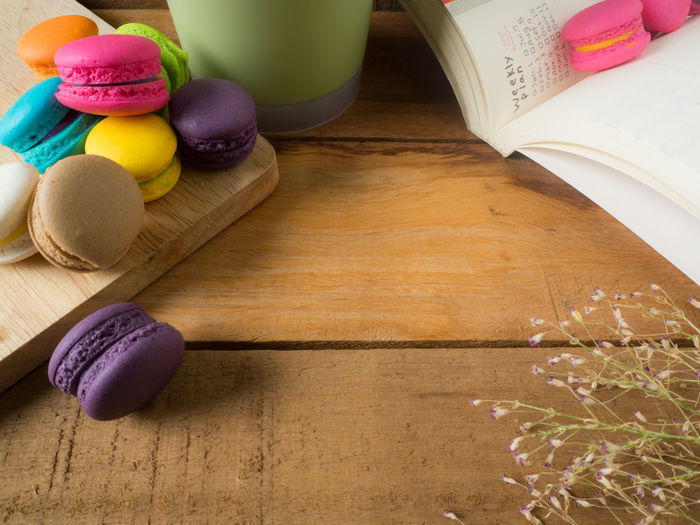 Colorful homemade macaroons staying on open book over valentines day concept. Background Biscuit Book Color Colorful Cookie Day Dessert Food French Hipster Love Macaroons Mint Paper Pastel Pink Retro Sweet Vintage White