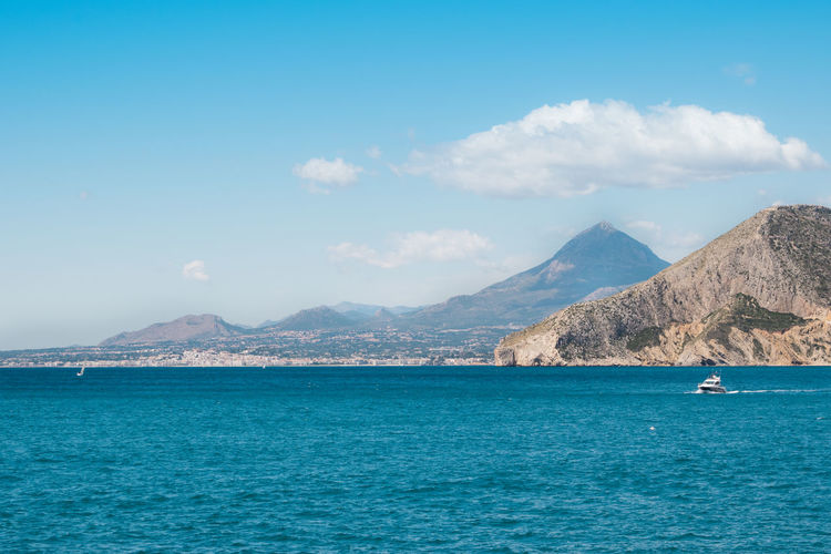 Seascape of Calpe and the mountains in the back Water Mountain Scenics - Nature Sky Beauty In Nature Waterfront Sea Mountain Range Nautical Vessel Tranquil Scene Cloud - Sky Nature Tranquility Blue Day Idyllic Transportation No People Non-urban Scene Outdoors Turquoise Colored