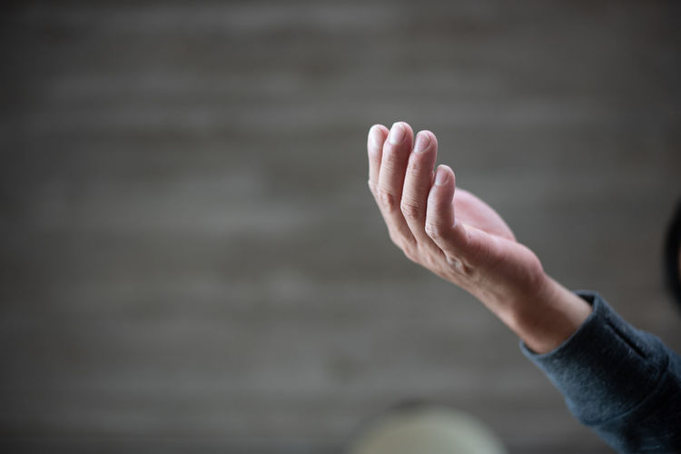hand for hope One Person Human Body Part Human Hand Real People Hand Body Part Focus On Foreground Lifestyles Day Unrecognizable Person Leisure Activity Finger Human Finger Water Outdoors Women Gesturing Nature Sea Human Limb Human Foot