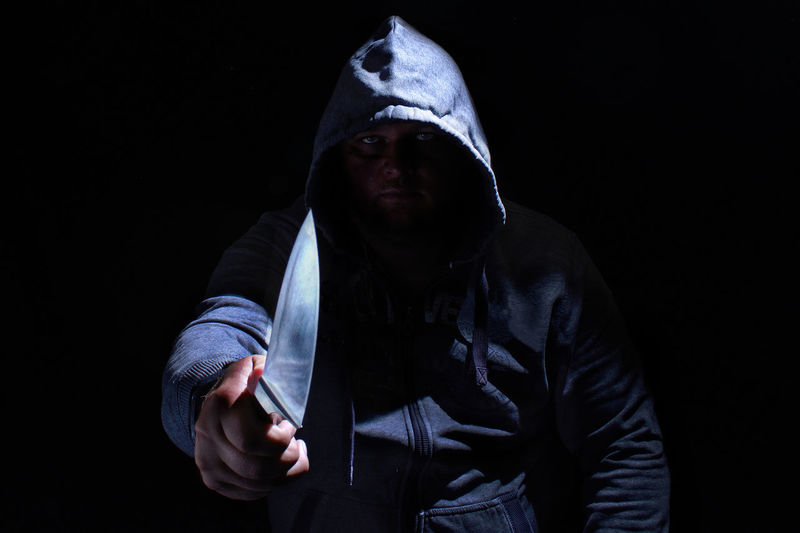 Crime Dark Death Horror Knife Aggression  Black Background Crime Evil Gangster Homicide Hood - Clothing Horror Portrait Killer Men Murderer Portrait Robbery Shadow Social Issues Thief Warning Sign Weapon