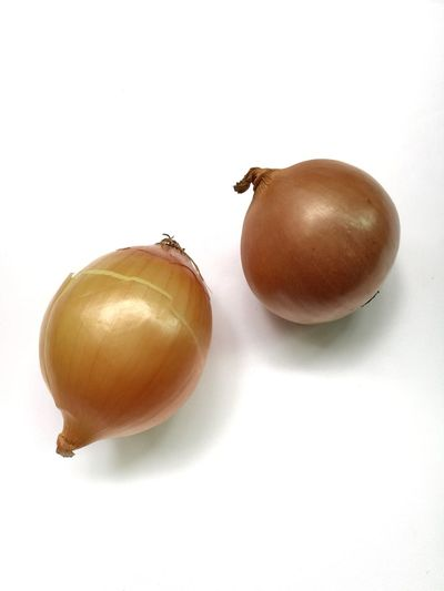 Top view of brown onions isolated on white background.
