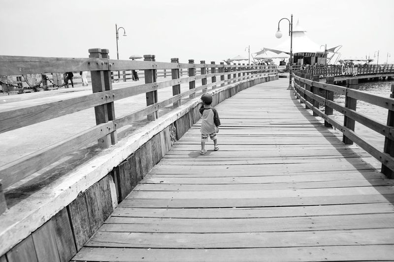 Bridge - Man Made Structure Full Length One Man Only One Person Outdoors Only Men Day Adult Adults Only Men Sport Sky People Real People Exercising Lifestyles City Water Sea Footbridge black&white