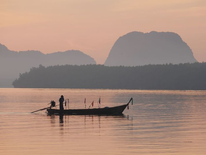 Fisherman with the longtail boat in the early morning at Ban Sam chong Tai , Pang -nga ,Thailand Transportation Vehicle Island Life Outdoor Photography Destination Travel Thailand Tropical Phang-nga Andaman Seascape Scenery Activity Long -tail Boat Fisherman Morning Time Early Morning Water Transportation Mode Of Transportation Real People Silhouette Lifestyles Nature Beauty In Nature Lake