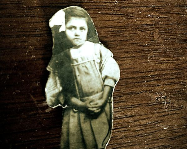 Creapy old photograph. Close-up Human Representation Wood Background Old Photograph Small Girl Art And Craft Old Photo Photo Creepy Child One Person The Portraitist - 2017 EyeEm Awards