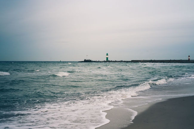 Sand | Sea | Lighthouse | Warnemünde | daylight Lighthouse Beach Beauty In Nature Day Horizon Over Water Nature No People Outdoors Sand Scenics Sea Travel Destinations Vacations Water Wave