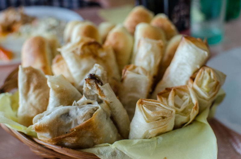 Close-up of spring rolls in container