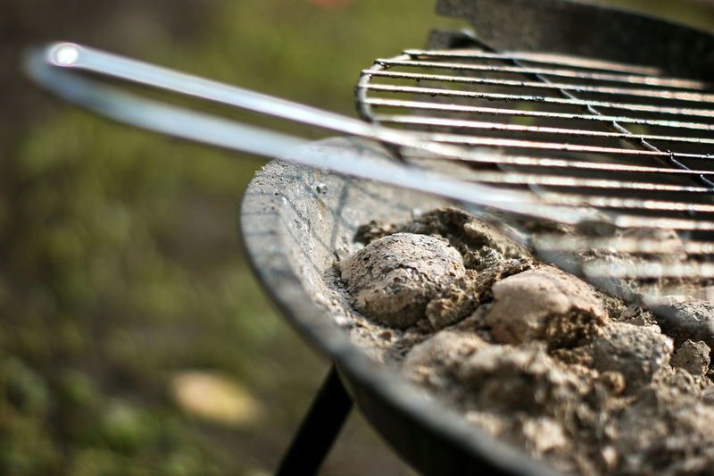 Grill Grilled Selective Focus Close-up Metal Day Food No People Food And Drink Kitchen Utensil Nature Barbecue Outdoors Preparation  Sunlight Barbecue Grill High Angle View Still Life Wood - Material Eating Utensil Focus On Foreground Freshness Sashalmi