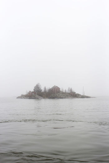 Archipelago Architecture Beauty In Nature Day Finland Fog Helsinki Inhabited Island Lonely Mist Nature Nautical Vessel No People Outdoors Sailing Scandinavia Scenics Sea Sky Small Island The Great Outdoors - 2017 EyeEm Awards Tranquility Water Waterfront