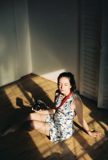 Analogue Photography Film Analog Photography Domestic Domestic Animals Film Photography Flooring Full Length Hairstyle Hardwood Floor Home Interior Indoors  Lifestyles Mammal One Animal One Person Pets Real People Shadow Sitting Superia Superia200 Women Wood Young Adult