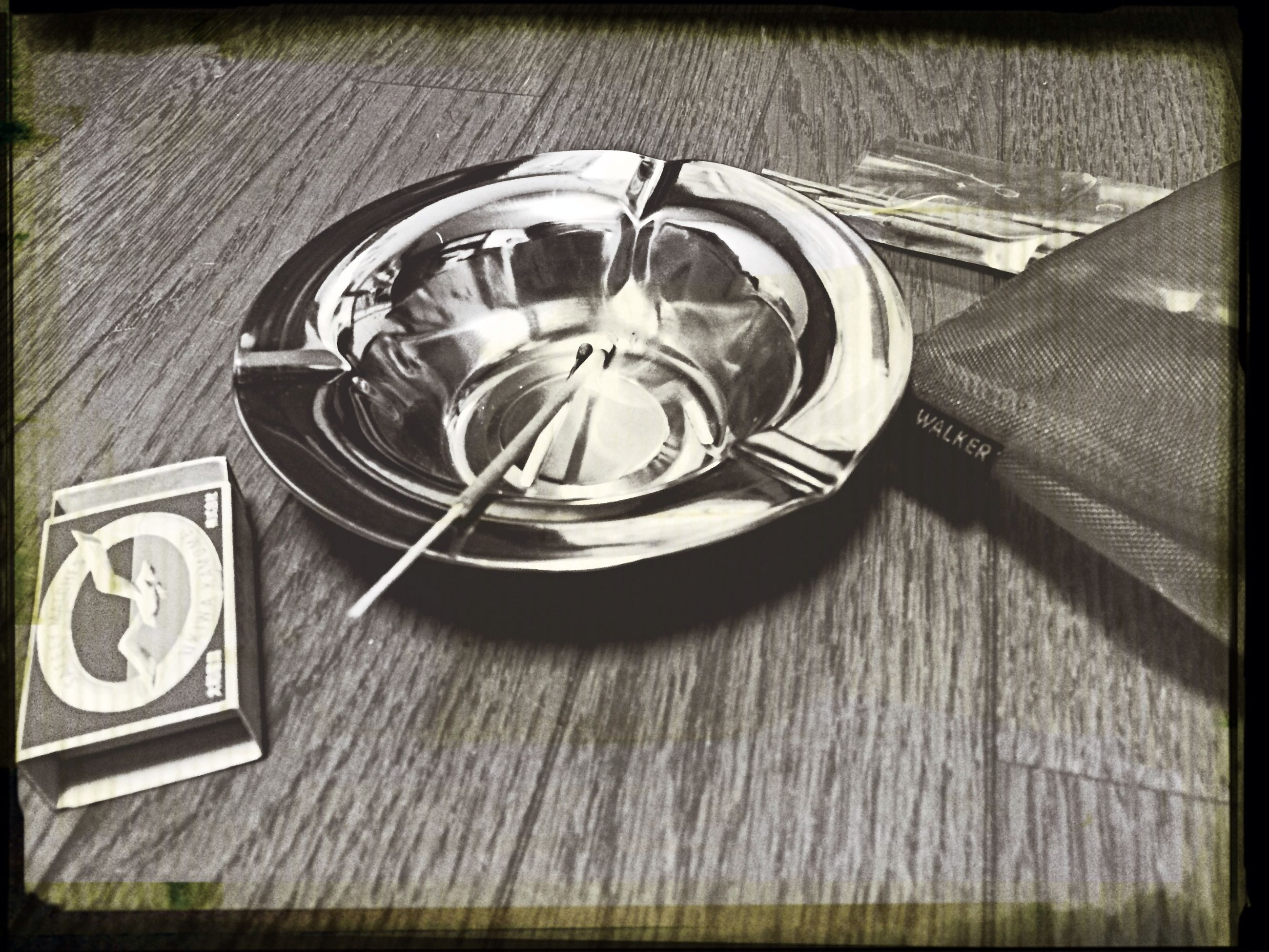 transfer print, auto post production filter, indoors, metal, circle, high angle view, close-up, still life, technology, no people, pattern, geometric shape, old-fashioned, table, directly above, retro styled, built structure, reflection, day, metallic