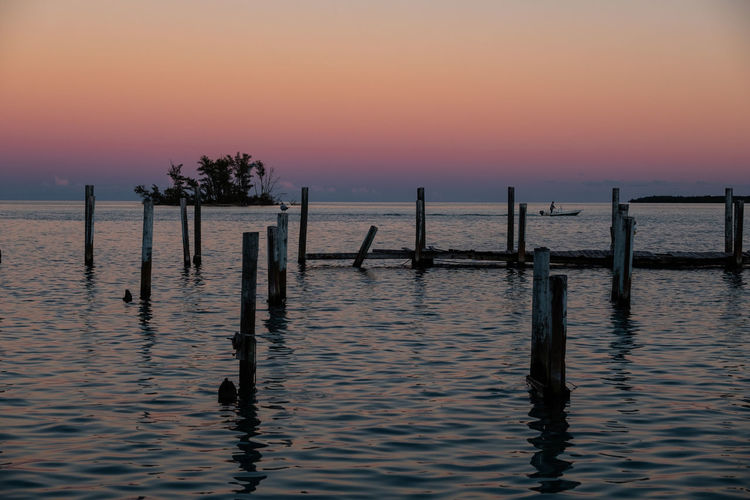 Beautiful Ending Boat Water Sky Sunset Scenics - Nature Beauty In Nature Sea Tranquility Waterfront Tranquil Scene Post Wooden Post Nature Wood - Material Orange Color Idyllic Silhouette No People Outdoors Pole