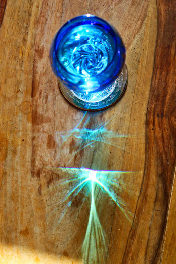 High angle view of illuminated glass on table