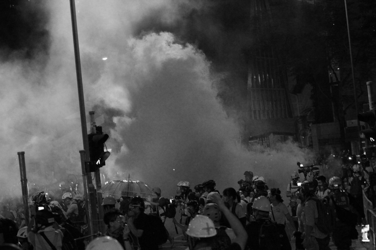 crowd, group of people, large group of people, real people, smoke - physical structure, city, street, architecture, protest, men, outdoors, event, building exterior, lifestyles, togetherness, built structure, protestor, women, night, riot, aggression, air pollution, pollution, festival