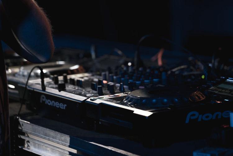 Close-up of sound mixer at music concert