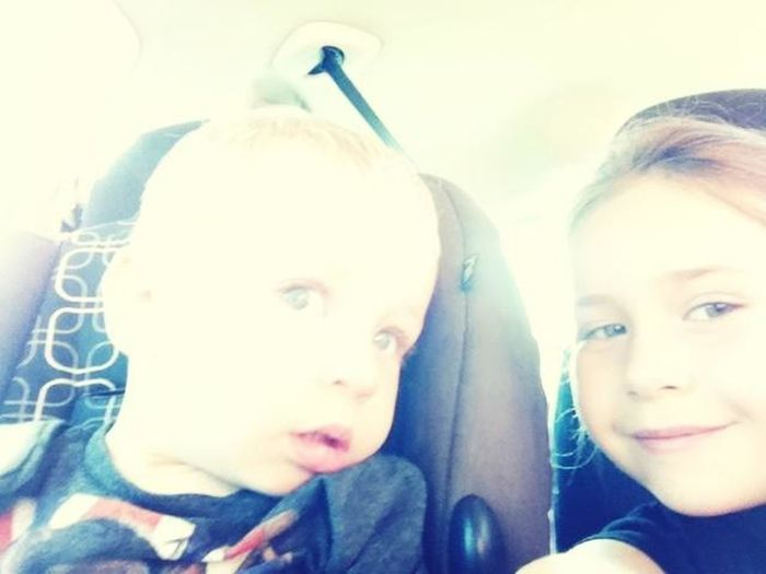 me and my brother in the car