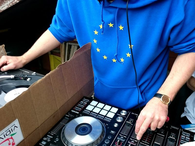 Europe Dj Brexit Music Turntable Midsection People Adults Only Arts Culture And Entertainment Adult Skill  Indoors  One Person DayOnly Men Real People Close-up Blue