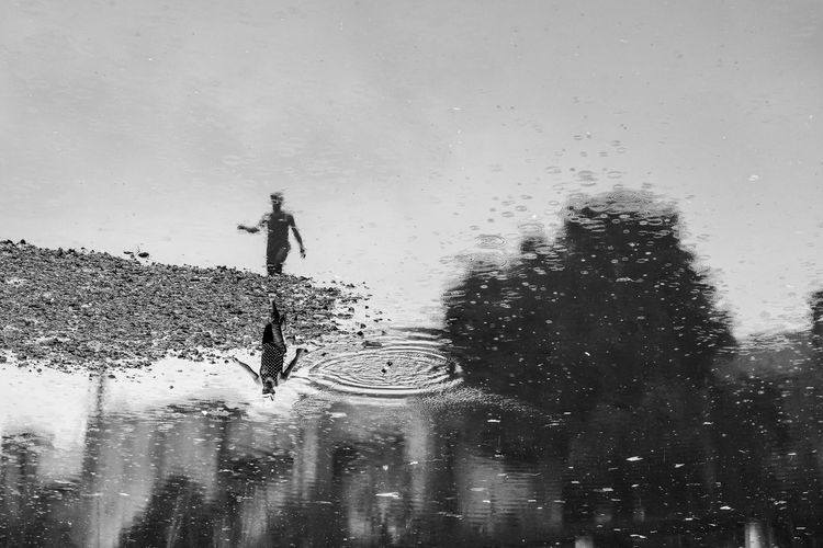 Day Drop Leisure Activity Men Nature One Person Real People Reflection Sky Walking Water Waterfront Wet