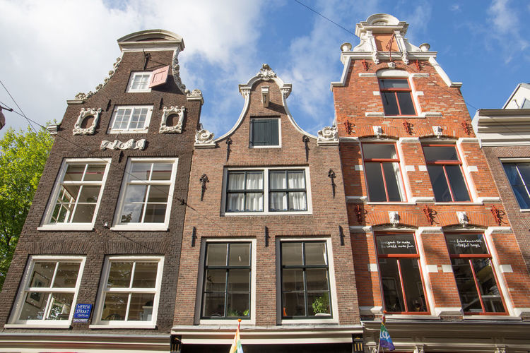 Amsterdam Netherlands Architecture Bell Gable Building Building Exterior Built Structure City Clock Cloud - Sky Day Dutch Houses Façade Facades Gables History Holland Low Angle View Nature No People Outdoors Religion Residential District Sky Sunlight The Past Tourism Tower Window