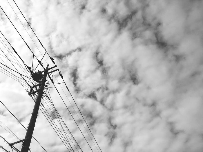 Low Angle View Electricity  Connection Electricity Pylon Fuel And Power Generation Cloud Sky Power Line  Technology Power Supply Cable Day Outdoors Tall Cloud - Sky Cloudscape Cloudy Blue No People Clouds